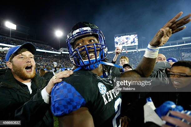 b819defa133 Alvin Dupree of the Kentucky Wildcats celebrates with fans after the game  against the South Carolina