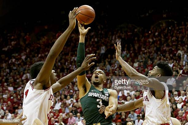 Alvin Ellis III of the Michigan State Spartans attempts a shot between Thomas Bryant and Robert Johnson of the Indiana Hoosiers in the second half at...