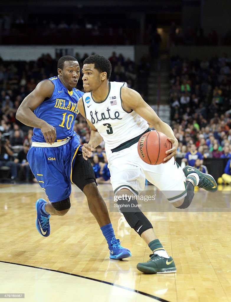 Alvin Ellis III of the Michigan State Spartans dribbles past Devon