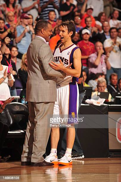 Alvin Gentry Head Coach of the Phoenix Suns congratulates Steve Nash during a break in the action against the San Antonio Spurs on April 25 2012 at...