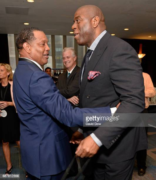 Alvin Gentry of the New Orleans Pelicans and Magic Johnson of the Los Angeles Lakers greet each other during the 2017 NBA Draft Lottery at the New...