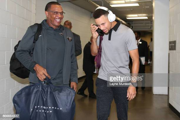 Alvin Gentry of the New Orleans Pelicans and Stephen Curry of the Golden State Warriors talk before the game on October 20 2017 at Smoothie King...
