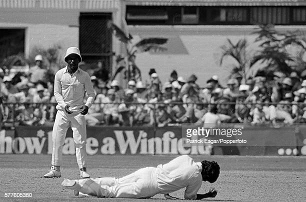 Alvin Kallicharran of West Indies lies on the ground after catching Rick McCosker of Australia for 1 in the 1st Test match between Australia and West...