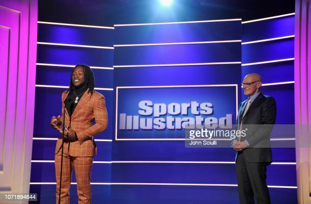 Alvin Kamara accepts the Breakout of the Year award from James Carville onstage during Sports Illustrated 2018 Sportsperson of the Year Awards Show...