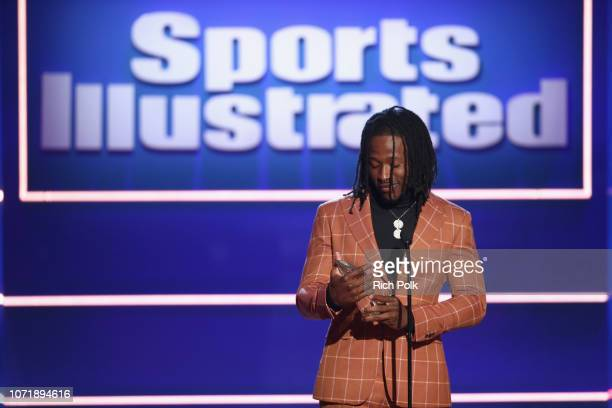 """Alvin Kamara accepts the """"Breakout of the Year"""" award onstage during Sports Illustrated 2018 Sportsperson of the Year Awards Show on Tuesday,..."""