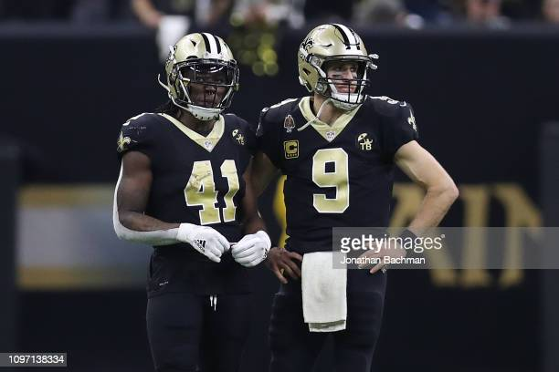 Alvin Kamara and Drew Brees of the New Orleans Saints look on against the Los Angeles Rams during the fourth quarter in the NFC Championship game at...