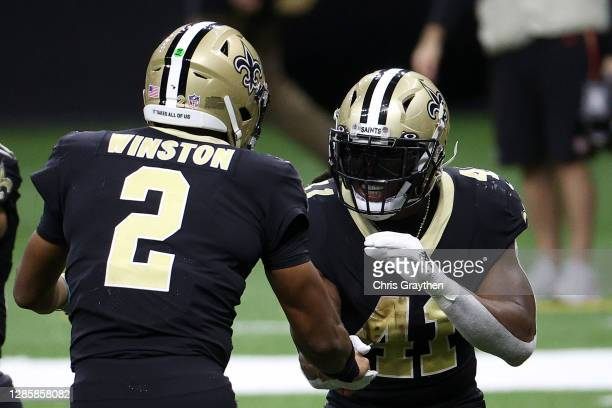 Alvin Kamara and Jameis Winston of the New Orleans Saints celebrate following a touchdown during their game against the San Francisco 49ers at...