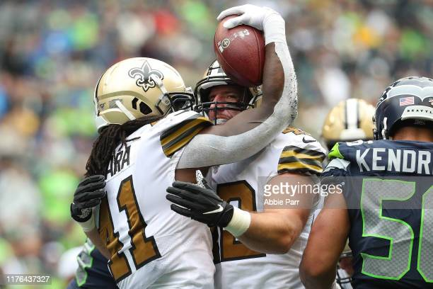 Alvin Kamara celebrates with Zach Line of the New Orleans Saints after scoring a one yard touchdown run in the fourth quarter against the Seattle...