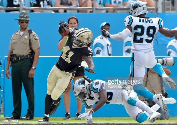 Alvin Kamara of the New Orleans Saints beats Mike Adams and Daryl Worley of the Carolina Panthers to the3 end zone for a touchdown during their game...