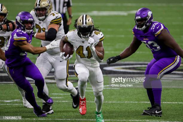 Alvin Kamara of the New Orleans Saints carries the ball during the first quarter against the Minnesota Vikings at Mercedes-Benz Superdome on December...