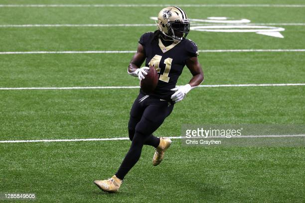 Alvin Kamara of the New Orleans Saints carries the ball in for a touchdown during their game against the San Francisco 49ers at Mercedes-Benz...