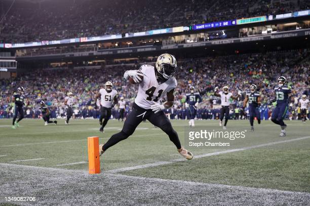 Alvin Kamara of the New Orleans Saints catches a pass for a touchdown during the first half against the Seattle Seahawks at Lumen Field on October...