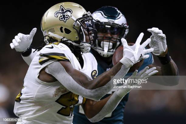 Alvin Kamara of the New Orleans Saints catches the ball for a touchdown as Malcolm Jenkins of the Philadelphia Eagles defends during the second half...