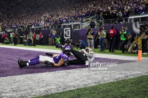 Alvin Kamara of the New Orleans Saints catches the ball for a touchdown over defender Eric Kendricks of the Minnesota Vikings to tie the game in the...