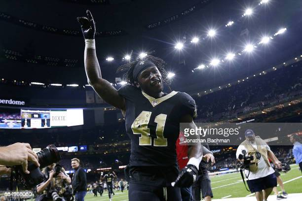 Alvin Kamara of the New Orleans Saints celebrates after a game against the Carolina Panthers at the MercedesBenz Superdome on December 3 2017 in New...