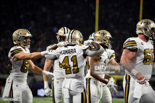 Alvin Kamara of the New Orleans Saints celebrates after scoring a touchdown in the first quarter of the game against the Minnesota Vikings at US Bank...