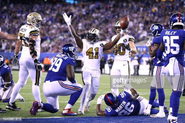 Alvin Kamara of the New Orleans Saints celebrates after scoring a touchdown against the New York Giants during the fourth quarter at MetLife Stadium...