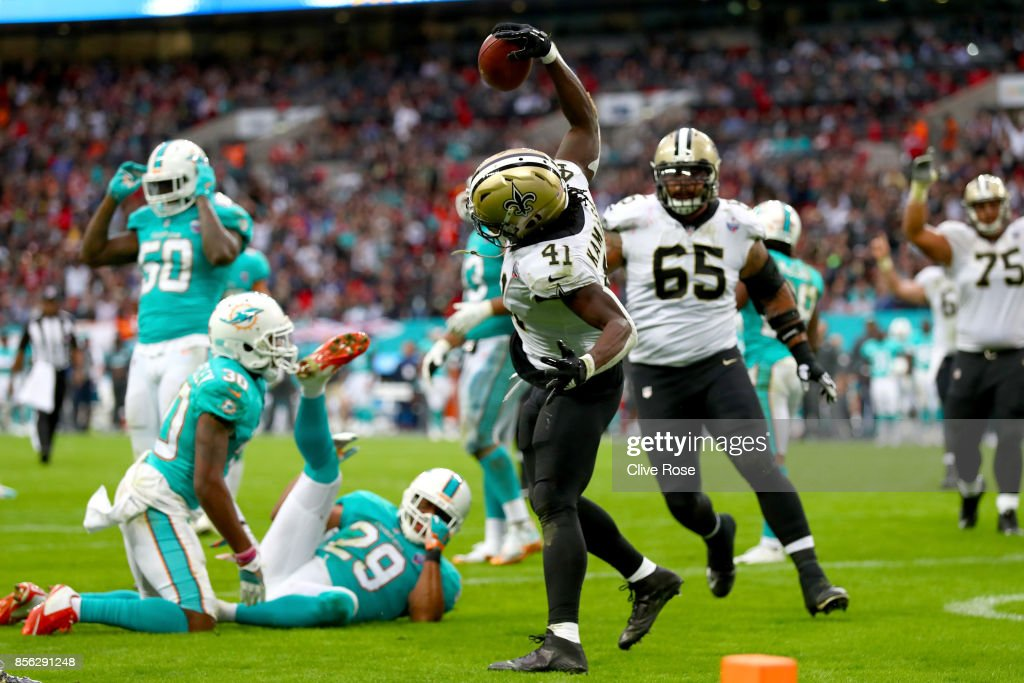 Alvin Kamara of the New Orleans Saints celebrates his touchdown during the NFL match between New Orleans Saints and Miami Dolphins at Wembley Stadium on October 1, 2017 in London, England.