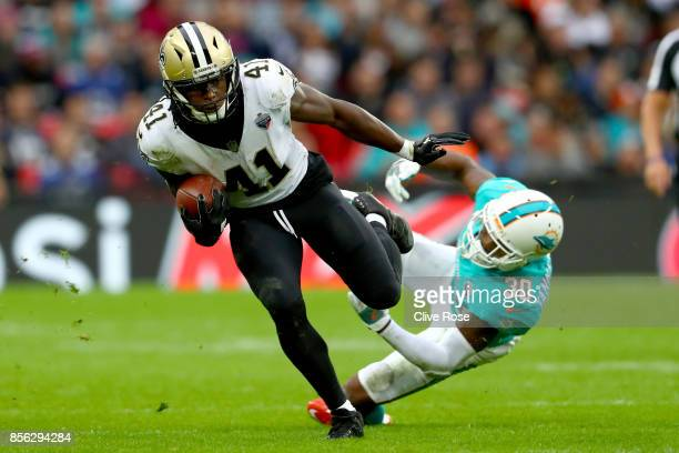 Alvin Kamara of the New Orleans Saints is challenged by Cordrea Tankersley of Miami Dolphins during the NFL match between New Orleans Saints...