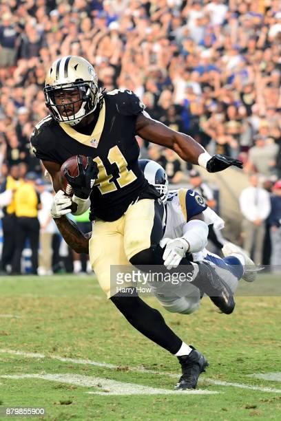 Alvin Kamara of the New Orleans Saints is chased down by John Johnson of the Los Angeles Rams during the fourth quarter at the Los Angeles Memorial...