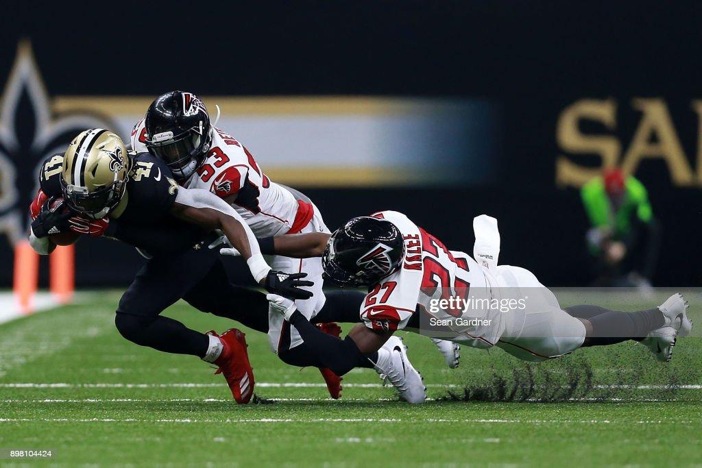 e30629637 ... Atlanta Falcons v New Orleans Saints Alvin Kamara 41 of the New Orleans  Saints is tackled by Damontae Kazee 27 ...