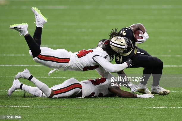 Alvin Kamara of the New Orleans Saints is tackled by Lavonte David and Jordan Whitehead of the Tampa Bay Buccaneers during the third quarter at the...