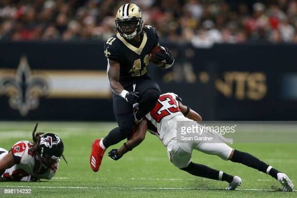 Alvin Kamara of the New Orleans Saints is tackled by Robert Alford of the Atlanta Falcons during the second half of a game at the MercedesBenz...