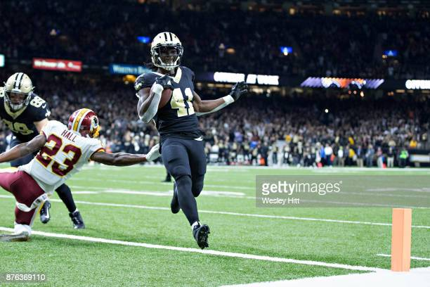 Alvin Kamara of the New Orleans Saints jumps runs the ball in for a touchdown during a game against the Washington Redskins at MercedesBenz Superdome...