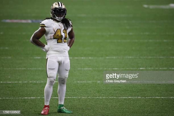 Alvin Kamara of the New Orleans Saints looks on during the fourth quarter against the Minnesota Vikings at Mercedes-Benz Superdome on December 25,...