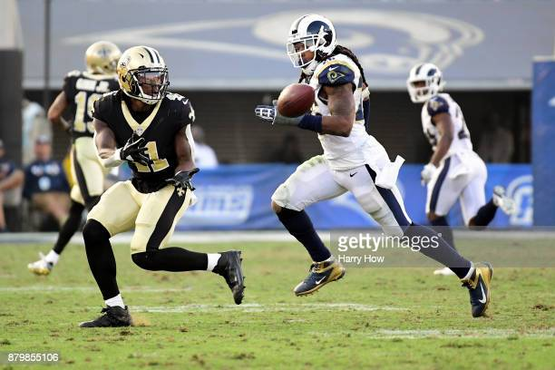 Alvin Kamara of the New Orleans Saints makes a catch in front of John Johnson of the Los Angeles Rams for a big gain during the fourth quarter at the...