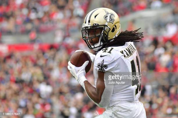 Alvin Kamara of the New Orleans Saints makes a reception during the first half of a football game against the Tampa Bay Buccaneers at Raymond James...