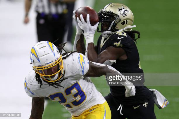 Alvin Kamara of the New Orleans Saints makes catch over Rayshawn Jenkins of the Los Angeles Chargers during their NFL game at Mercedes-Benz Superdome...