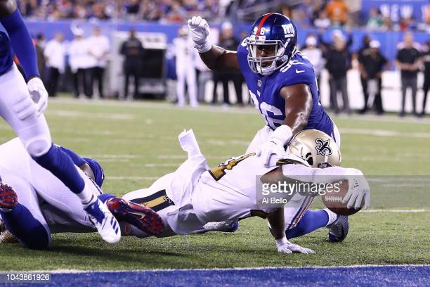 Alvin Kamara of the New Orleans Saints reaches to score a touchdown against the New York Giants during the fourth quarter at MetLife Stadium on...