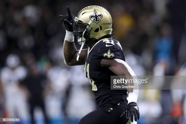 Alvin Kamara of the New Orleans Saints reacts after scoring a touchdown against the Carolina Panthers at the MercedesBenz Superdome on January 7 2018...