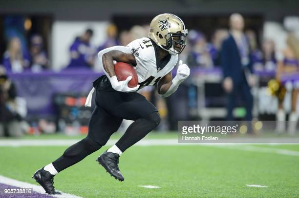 Alvin Kamara of the New Orleans Saints returns a kick against the Minnesota Vikings during the first half of the NFC Divisional Playoff game on...