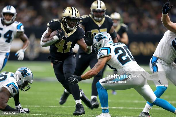 Alvin Kamara of the New Orleans Saints runs the ball against the Carolina Panthers during the second half of a NFL game at the MercedesBenz Superdome...