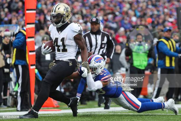 Alvin Kamara of the New Orleans Saints runs the ball as Micah Hyde of the Buffalo Bills attempts to tackle him during the third quarter on November...