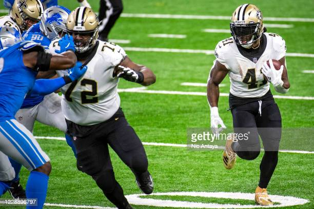 Alvin Kamara of the New Orleans Saints runs the ball during the second quarter against the Detroit Lions at Ford Field on October 4, 2020 in Detroit,...