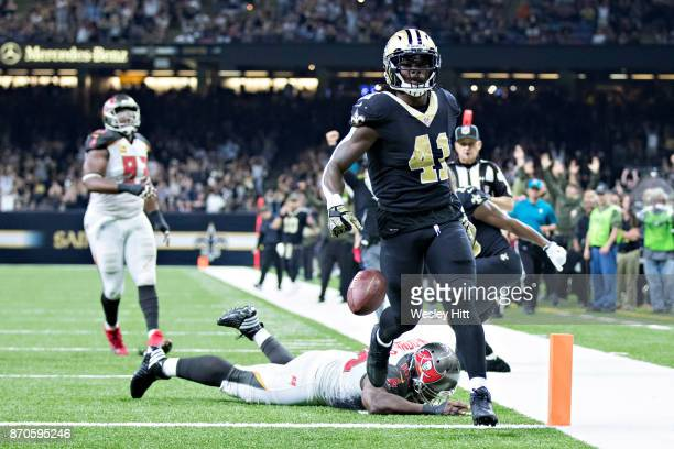 Alvin Kamara of the New Orleans Saints runs the ball in for a touchdown during a game against the Tampa Bay Buccaneers at MercedesBenz Superdome on...