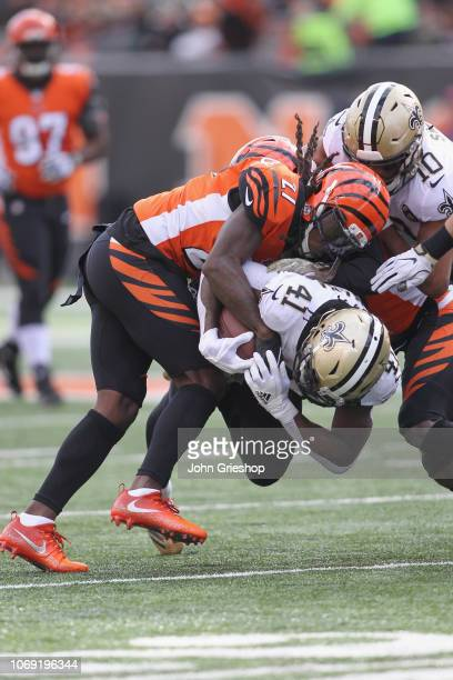 Alvin Kamara of the New Orleans Saints runs the football upfield against Dre Kirkpatrick of the Cincinnati Bengals during their game at Paul Brown...