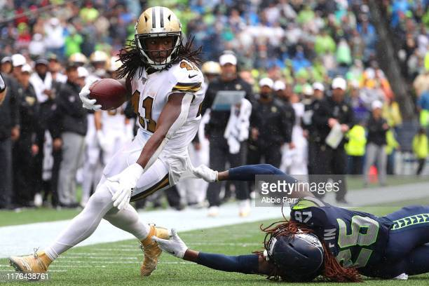 Alvin Kamara of the New Orleans Saints runs with the ball against Shaquill Griffin of the Seattle Seahawks in the third quarter during their game at...