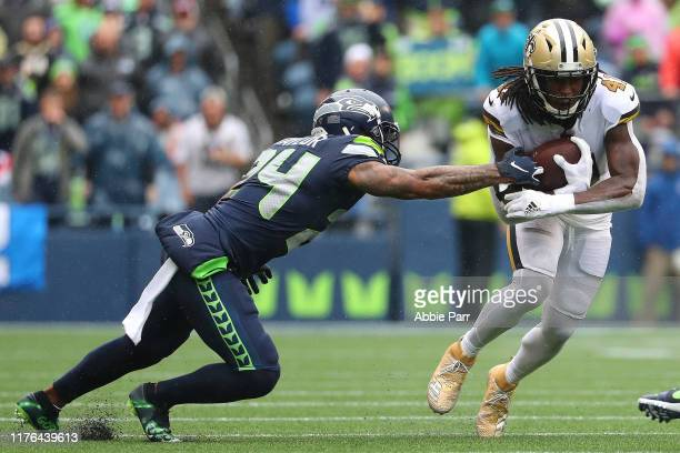 Alvin Kamara of the New Orleans Saints runs with the ball against Jamar Taylor of the Seattle Seahawks in the third quarter during their game at...