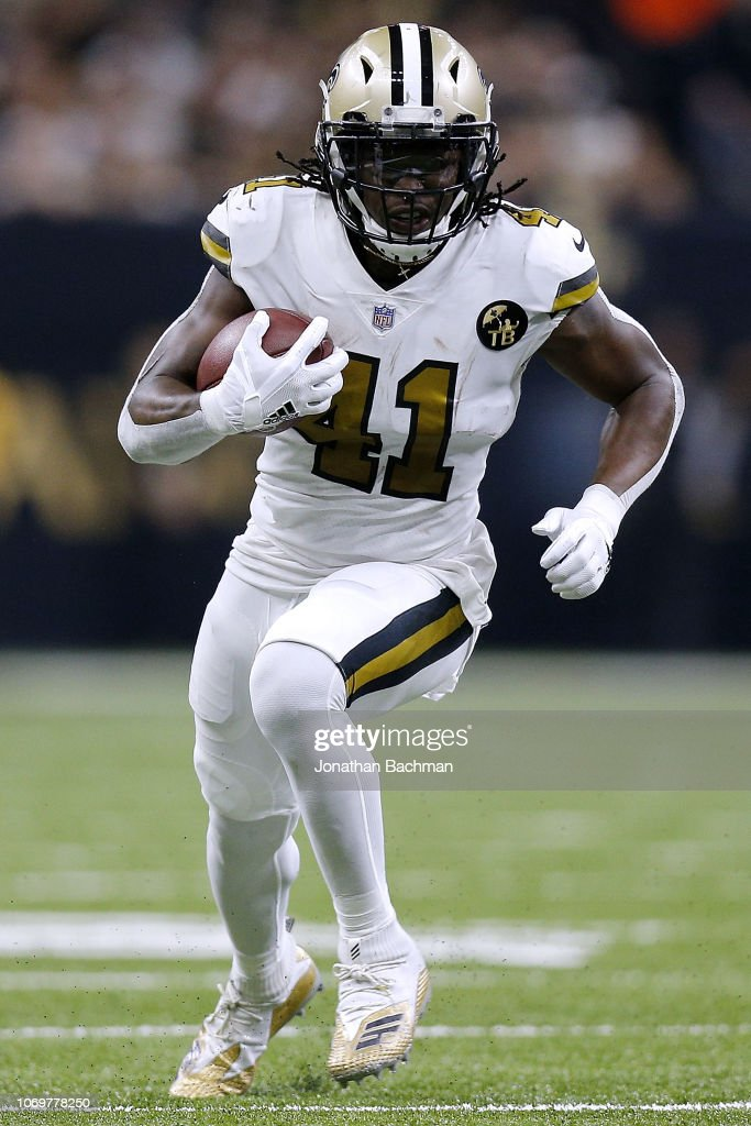 Alvin Kamara of the New Orleans Saints runs with the ball ...