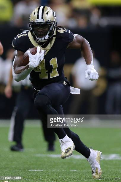 Alvin Kamara of the New Orleans Saints runs with the ball during a game against the Carolina Panthers at the Mercedes Benz Superdome on November 24...