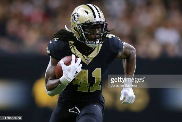 Alvin Kamara of the New Orleans Saints runs with the ball during the second half of a game against the Tampa Bay Buccaneers at the Mercedes Benz...