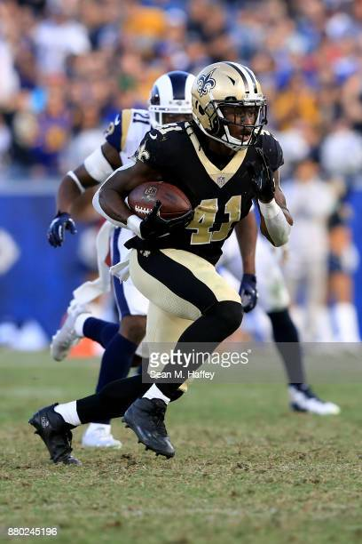 Alvin Kamara of the New Orleans Saints runs with the ball during the second half of a game against the Los Angeles Rams at Los Angeles Memorial...