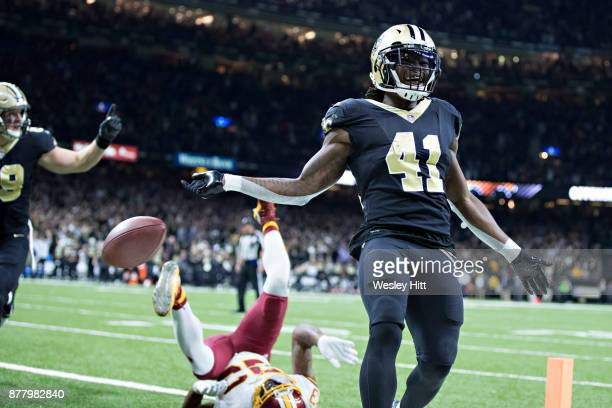 Alvin Kamara of the New Orleans Saints rushes for a touchdown past the outstretched arm of DeAngelo Hall of the Washington Redskins at MercedesBenz...