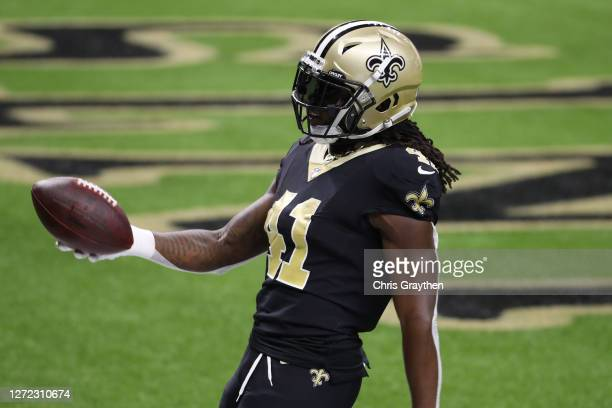 Alvin Kamara of the New Orleans Saints scores a touchdown against the Tampa Bay Buccaneers during the second quarter at the Mercedes-Benz Superdome...
