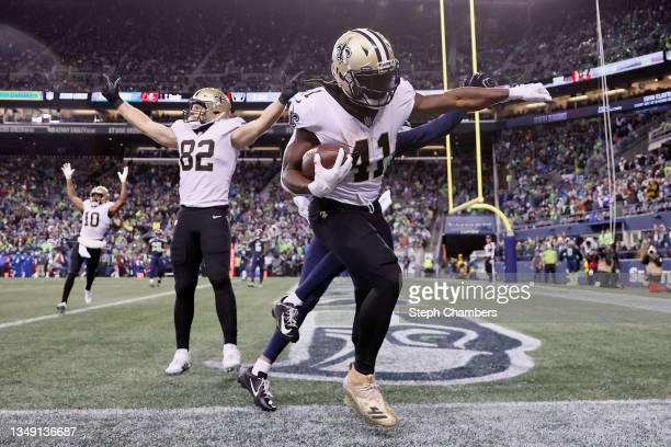Alvin Kamara of the New Orleans Saints scores a touchdown against the Seattle Seahawks during the second quarter at Lumen Field on October 25, 2021...