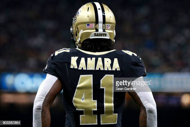 Alvin Kamara of the New Orleans Saints stands on the field during the first half of the NFC Wild Card playoff game against the Carolina Panthers at...